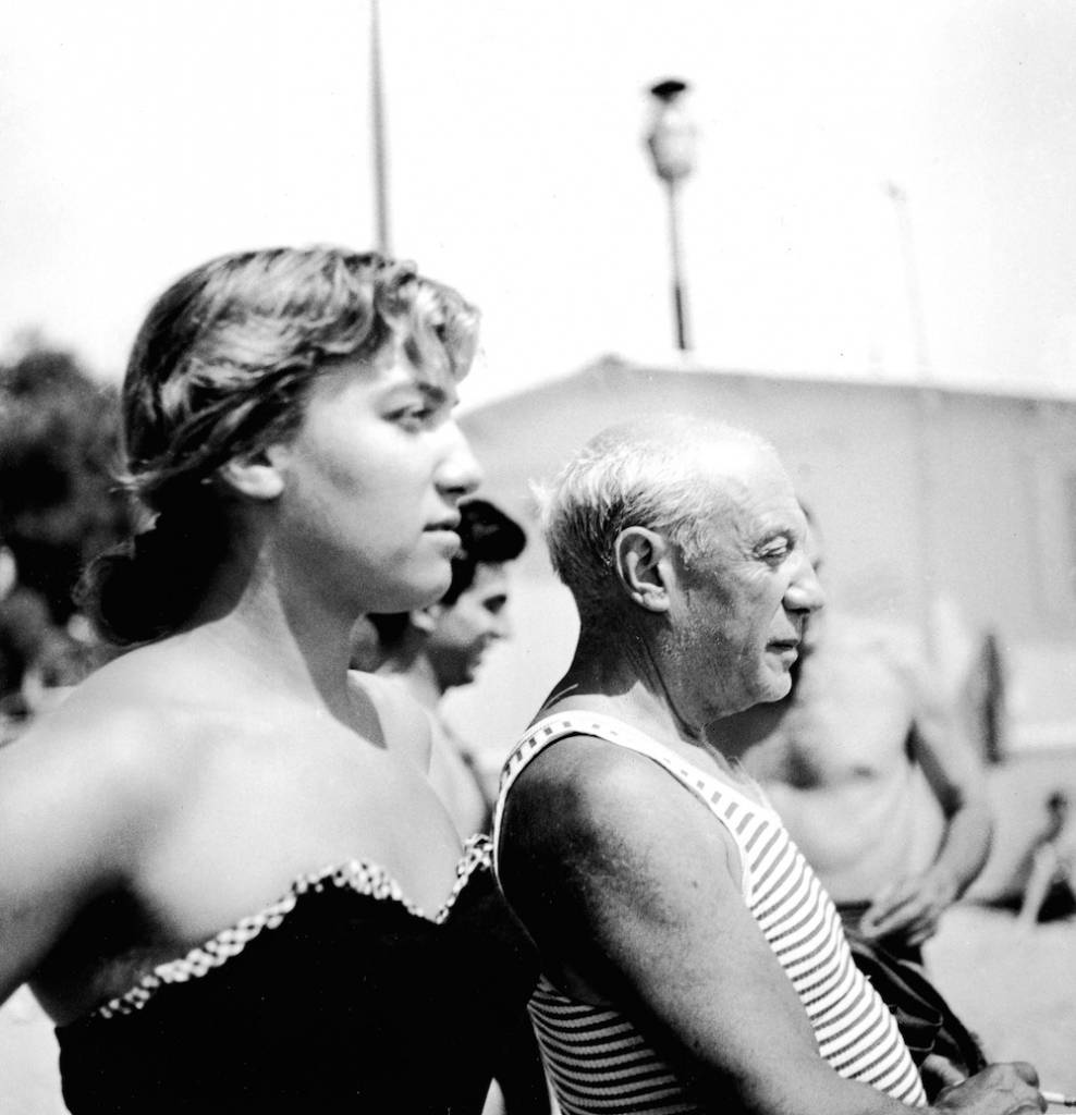 Spanish painter Pablo Picasso (1881 - 1973) and a young woman watch a bullfight, Spain, 1960s. (Photo by Hulton Archive/Getty Images)