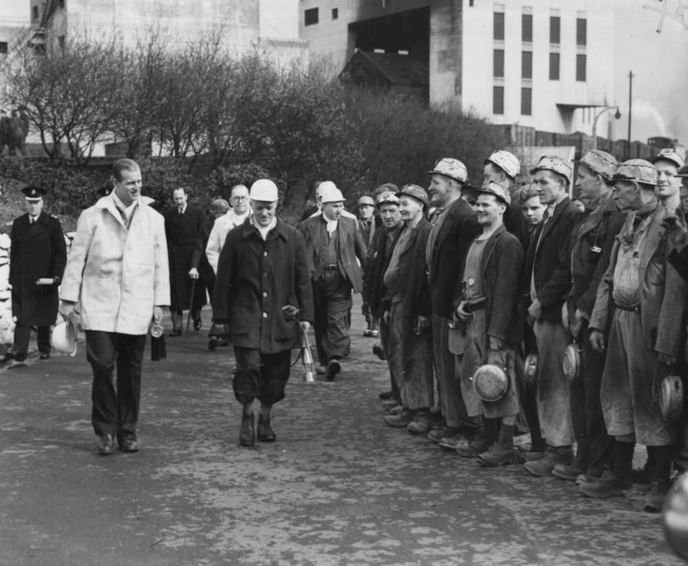 Prince Philip (left), the Duke of Edinburgh, is escorted by H Aspinall, the manager of Pits 1 and 2 at Mosley Common, as they meet a party of miners at the colliery, Manchester, April 4th 1952. (Photo by J. Hardman/Fox Photos/Getty Images)