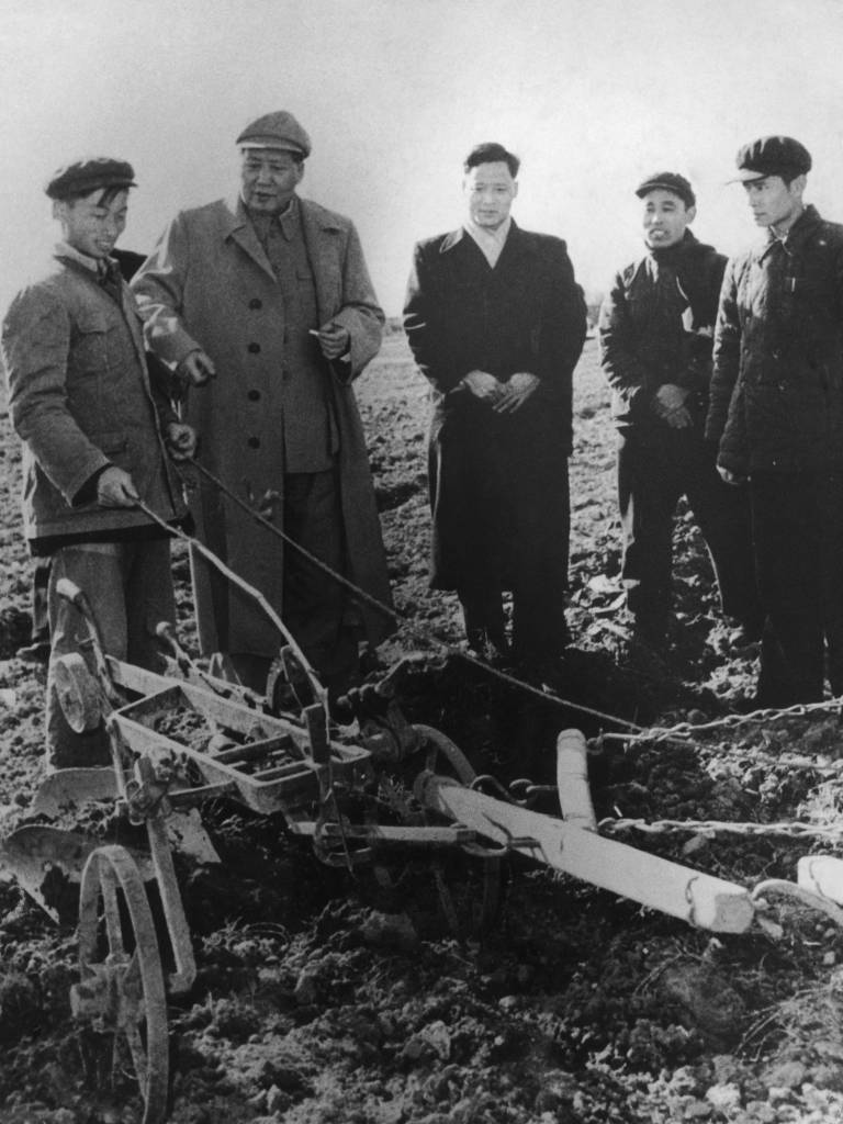 Chinese Communist Party Chairman Mao Zedong (1893 - 1976, second from left) visiting farm workers to congratulate them on production figures at their agricultural institute in Zhejiang, China, 9th February 1958. (Photo by Keystone/Hulton Archive/Getty Images)