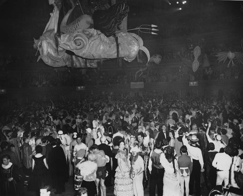 The Chelsea Arts Ball on New Year's Eve at the Albert Hall in London, 31st December 1954. The theme of the ball was 'The Seven Seas' and a large model of the Roman sea god Neptune hangs above the revellers. (Photo by Keystone/Hulton Archive/Getty Images)