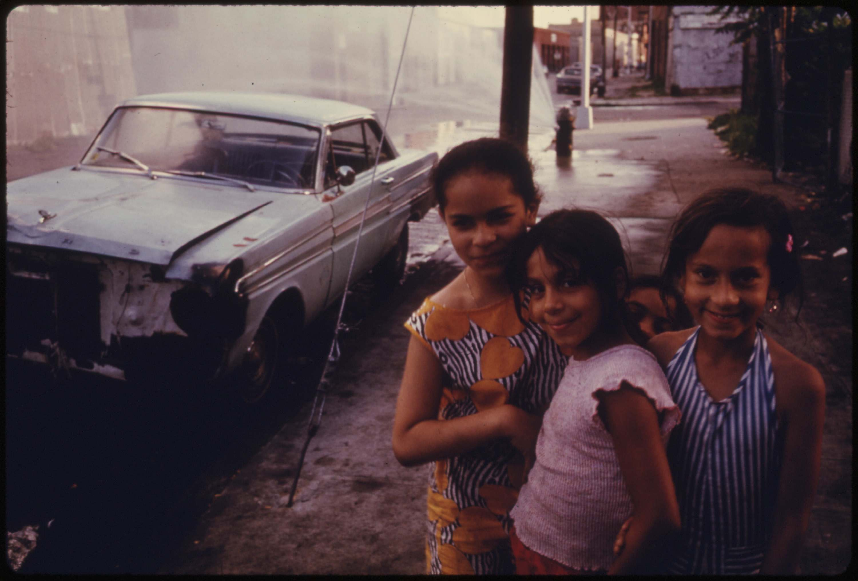 Three young girls on Bond Street, Brooklyn, July 1974.