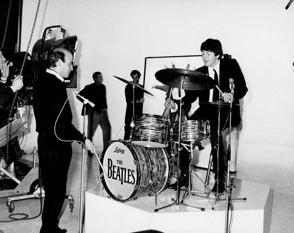 Richard Lester and Paul McCartney on drums.