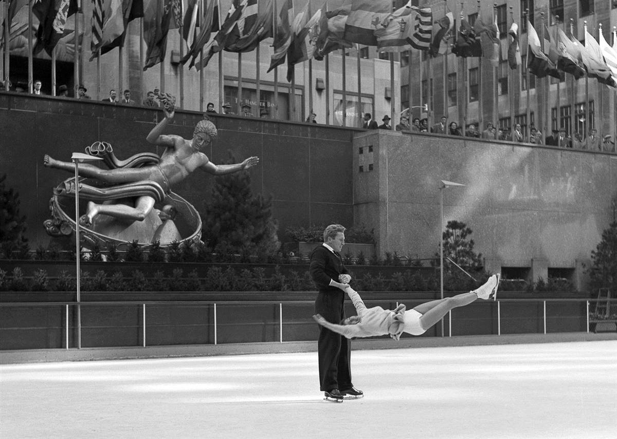 rofessional skaters make a gutsy move in this shot, taken at the Rockefeller Center rink.