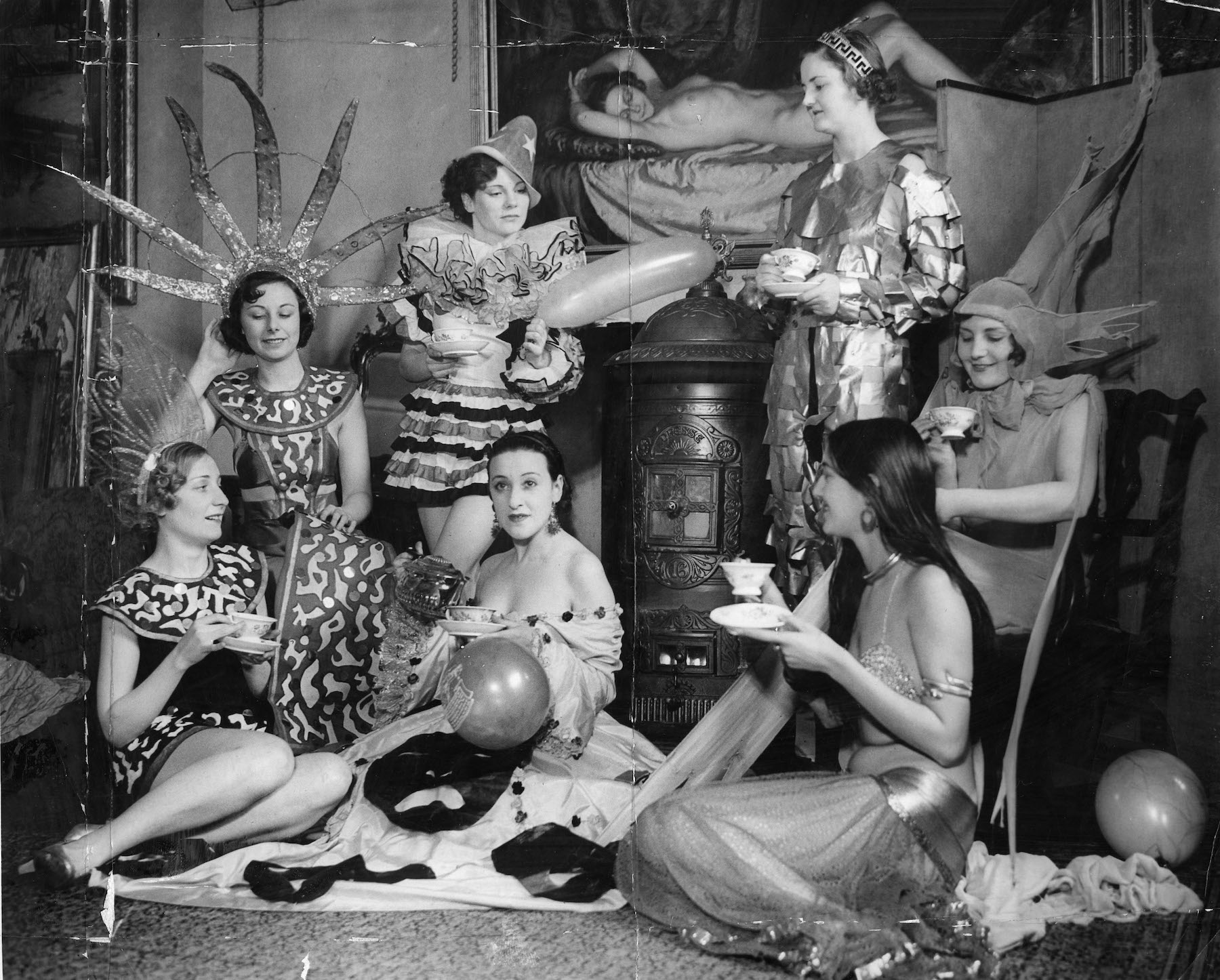 Chelsea Arts Ball Girls In Costume Take A Break For Refreshments During Rehearsals. The Albert Hall New Year's Eve.