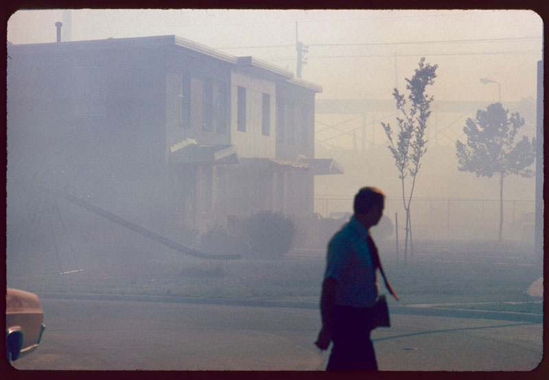 """Industrial smog blacks out homes adjacent to North Birmingham pipe plant. This is the most heavily polluted area of the city."" Leroy Woodson, Birmingham, Alabama, July 1972. National Archives, Records of the Environmental Protection Agency"