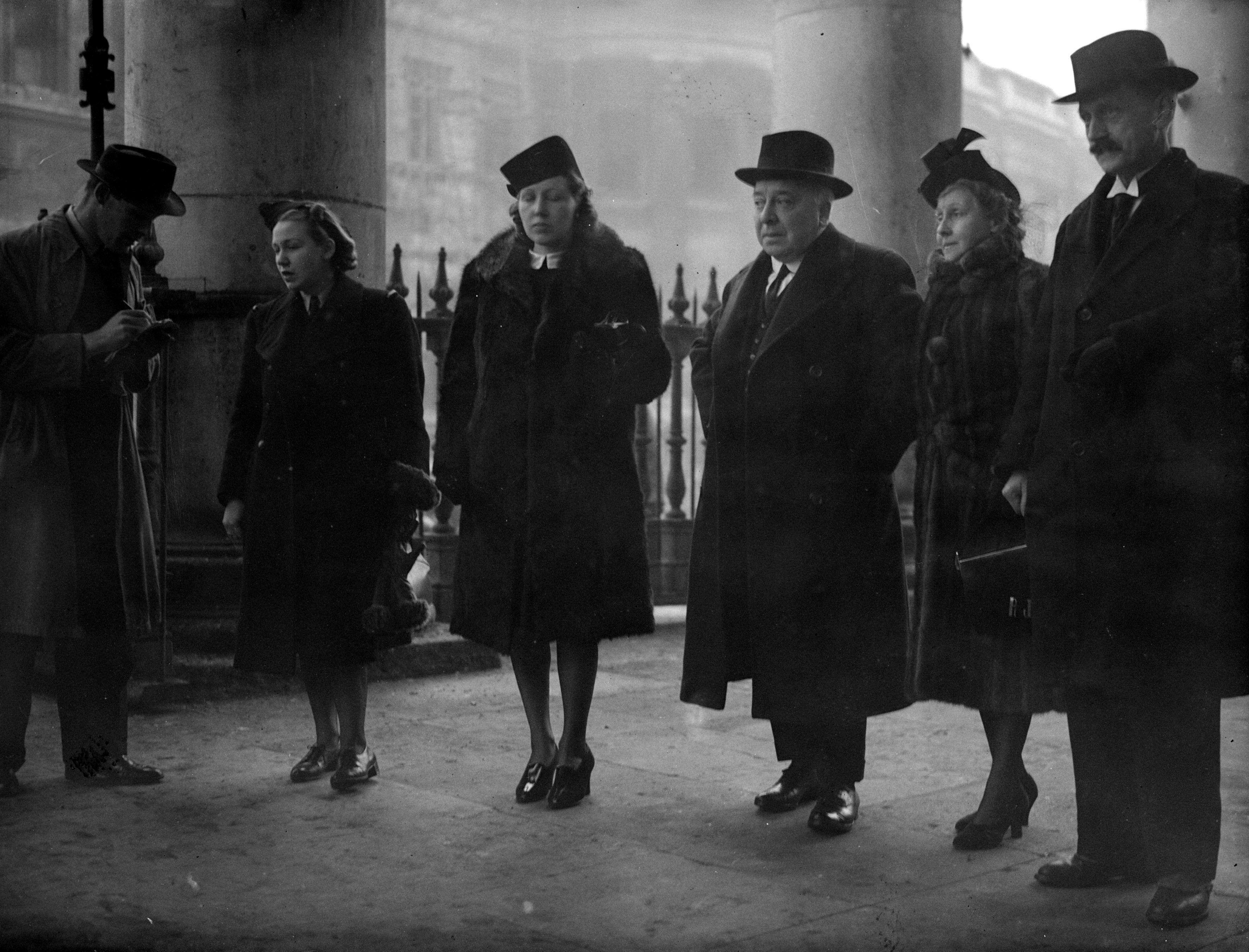 14th January 1941: Relatives arriving at the church of St Martin-in-the-fields to attend the memorial service for aviation pioneer Amy Johnson (1903 - 1941). Johnson was killed after in January 1941 after bailing out of her aircraft over the Thames Estuary while flying for the Air Transport Auxiliary. Among the relatives are Amy Johnson's father (centre) and Betty Johnson (left) in ATA uniform. (Photo by Denn/Keystone/Getty Images)