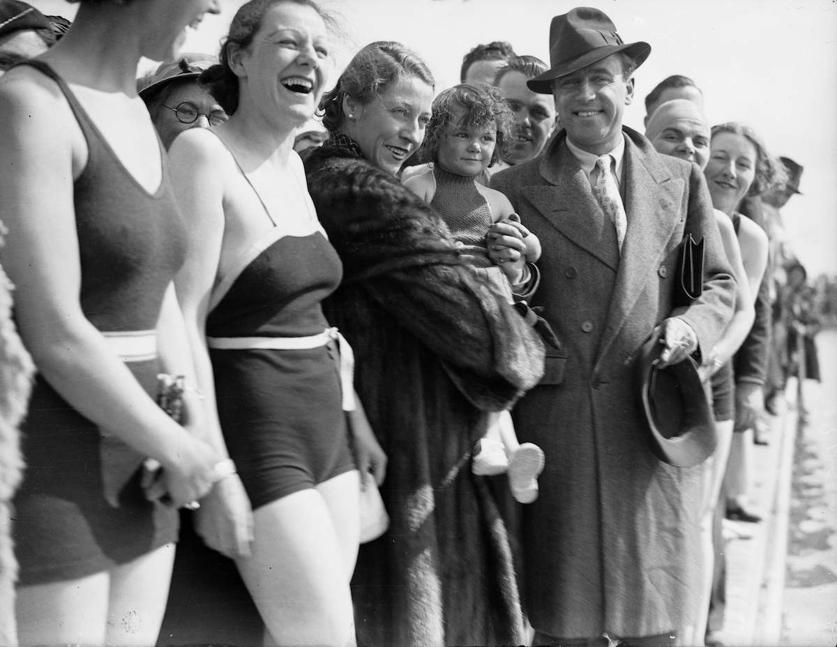31st May 1936: Aviators Amy Johnson (1903 - 1981) and her husband Jim Mollison (1905 - 1959) open the bathing pool at Butlin's Holiday Camp in Skegness. (Photo by George W. Hales/Fox Photos/Getty Images)