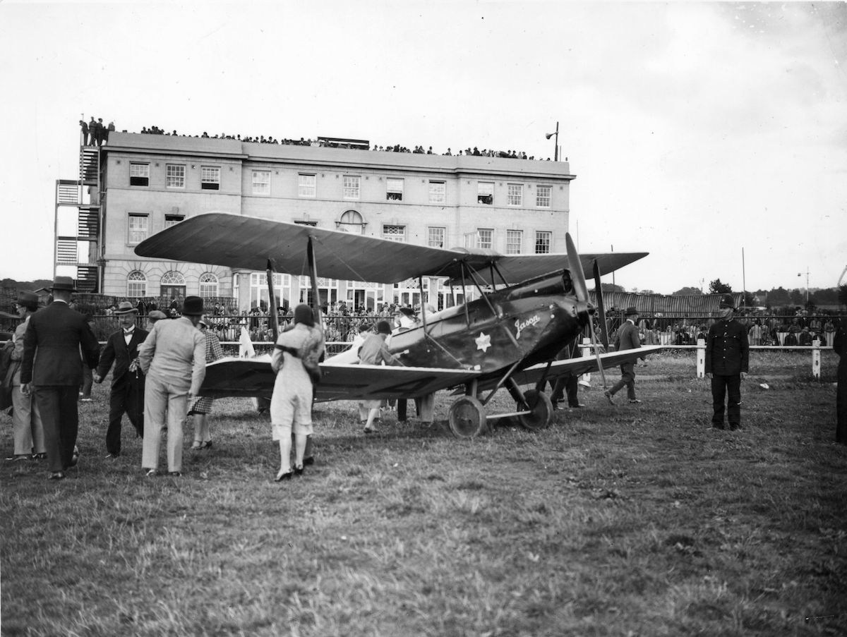 5th August 1930: English aviator Amy Johnson (1903 - 1941), arrive back in Britain with her 'Jason' plane after her pioneering solo flight to Australia. (Photo by Topical Press Agency/Getty Images)