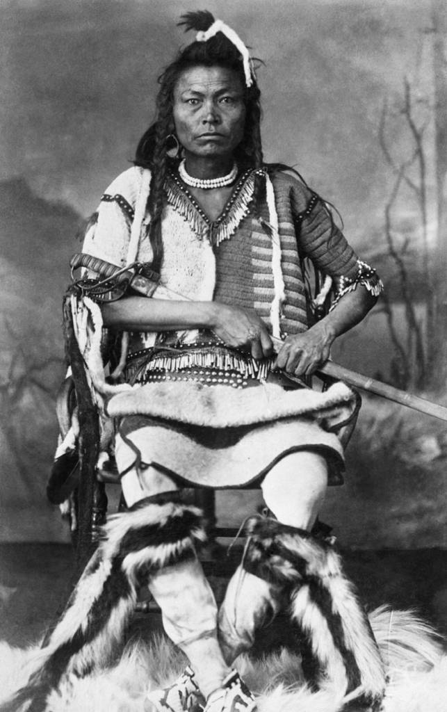 Blackfoot warrior with sword. Date: [ca. 1887]