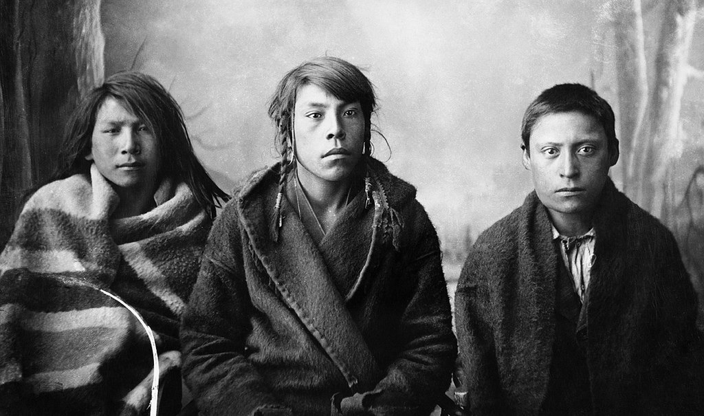 Three young Blackfoot men, Calgary, Alberta. Date: [ca. 1887]