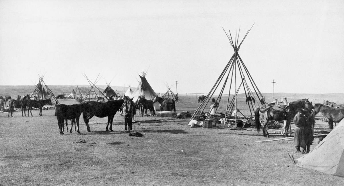 Sarcee (Tsuu T'ina) people moving camp on outskirts of Calgary, Alberta. Date: [ca. 1887]