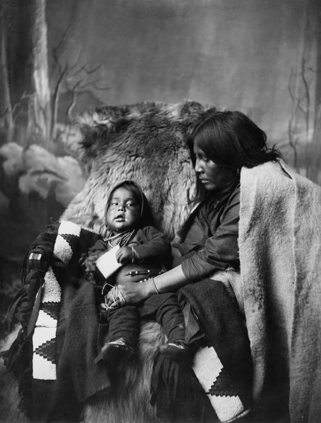 Blackfoot woman and child. Date: [ca. late 1880s]