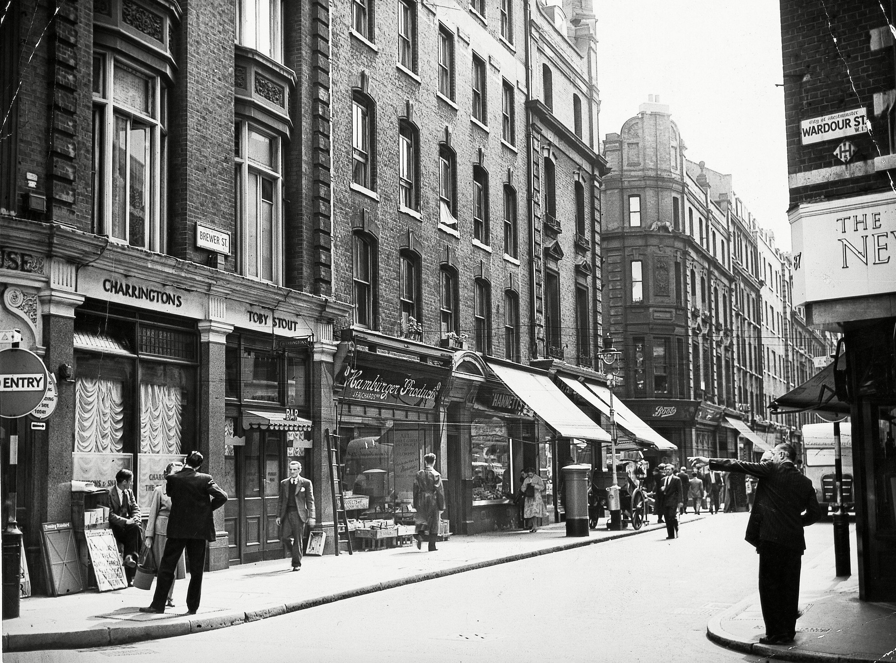 Brewer Street and the corner of Wardour Street in Soho, London, - Jul 1956. Photo by Daily Mail/REX/Shutterstock