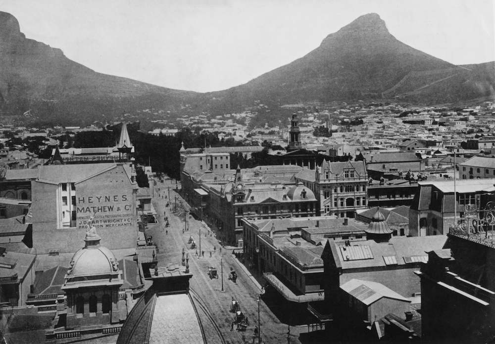 A view of Adderley Street in Cape Town, South Africa, from the tower of the Post Office, with Lion's Head mountain in the background, circa 1890. This suburb is known as 'Tamboer's Kloof', (Photo by Pocock/Hulton Archive/Getty Images)