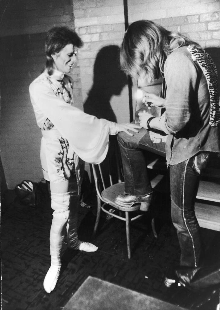 Make-up artist Pierre La Roche prepares English singer David Bowie for a performance as Aladdin Sane, 1973. Bowie is wearing a costume by Japanese designer Kansai Yamamoto. (Photo by Daily Express/Hulton Archive/Getty Images)