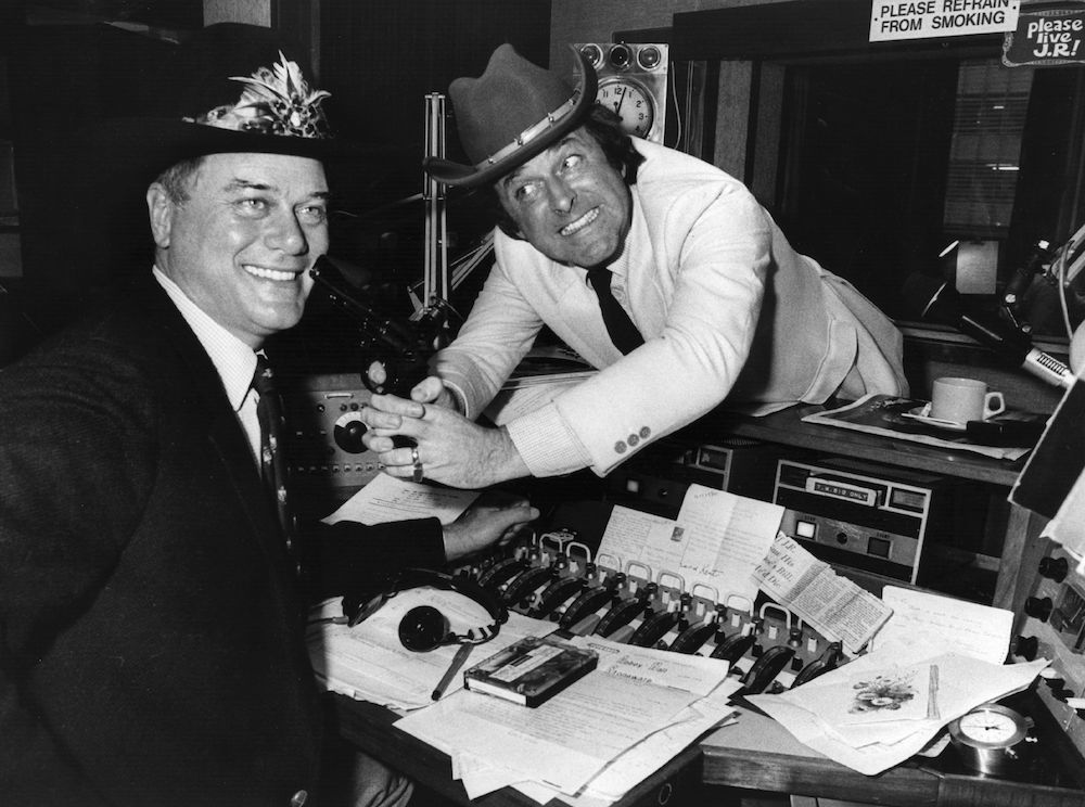 Irish television chat show celebrity and radio broadcaster Terry Wogan with American soap star Larry Hagman, who plays JR in 'Dallas'. At the time, 'Who Shot JR?' was the burning question on the lips of a nation of soap addicts, and Wogan is eagerly exploiting the photo-opportunity on his radio show. Original Publication: People Disc - HP0168 (Photo by Tony Weaver/Getty Images)