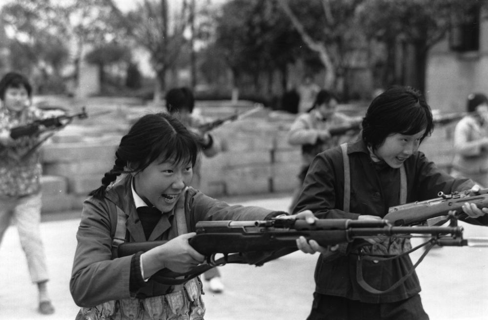 In Maoist China, Shanghai girls are taught how to kill with bayonetted rifles, demonstrated here in an exercise drill. (Photo by McCarthy/Getty Images)
