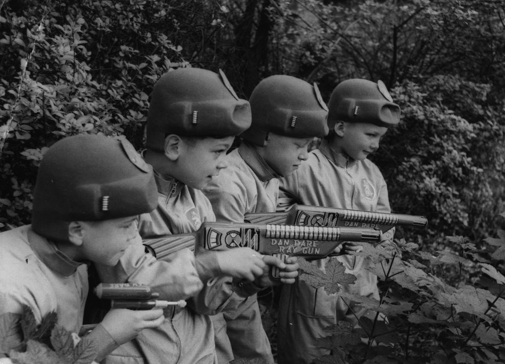 Four boys wearing space suits holding Dan Dare ray guns. (Photo by Keystone Features/Getty Images)