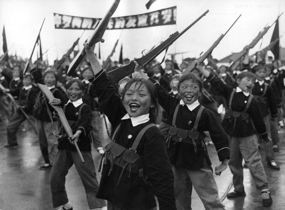 Chinese schoolchildren give a demonstration of their military skills in Hanking, where lessons include pre-military exercises using wooden weapons. (Photo by Keystone/Getty Images)