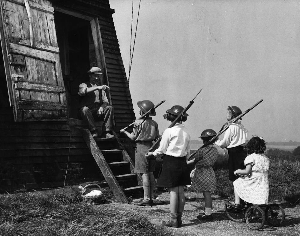 4th June 1941: A schoolboy takes careful aim during a gun class at his preparatory school in Maidenhead, Berkshire. (Photo by Fred Morley/Fox Photos/Getty Images)
