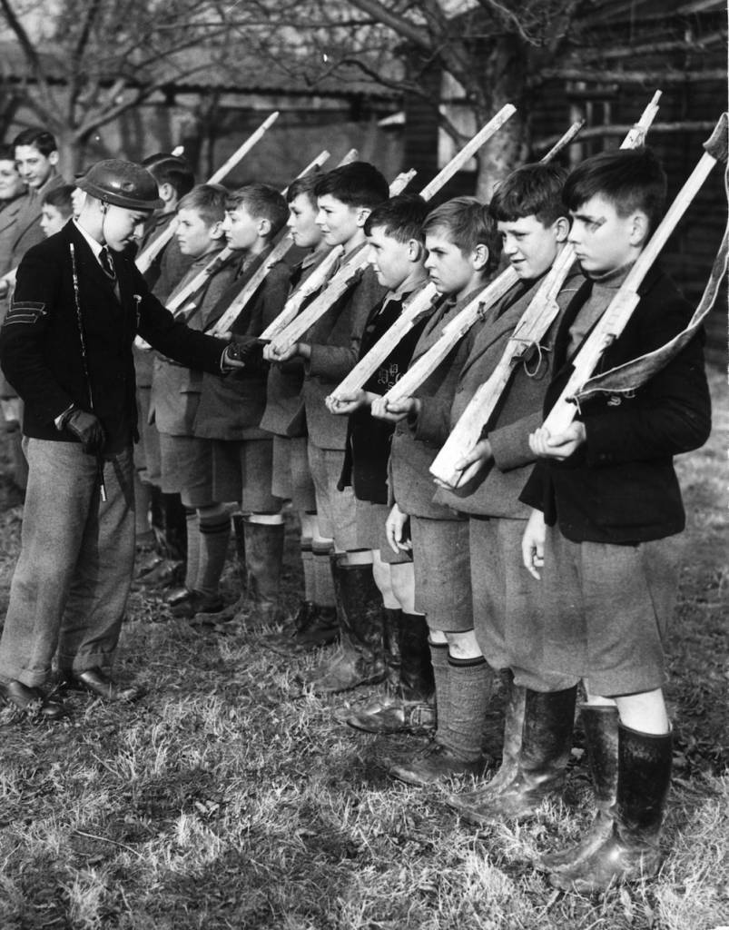 24th November 1939: A young 'Sergeant Major' inspects some of the Dulwich College Preparatory schoolboys who have been evacuated to Kent at the start of WW II. The 'soldiers' carry wooden guns and wear short trousers ! (Photo by Reg Speller/Fox Photos/Getty Images)