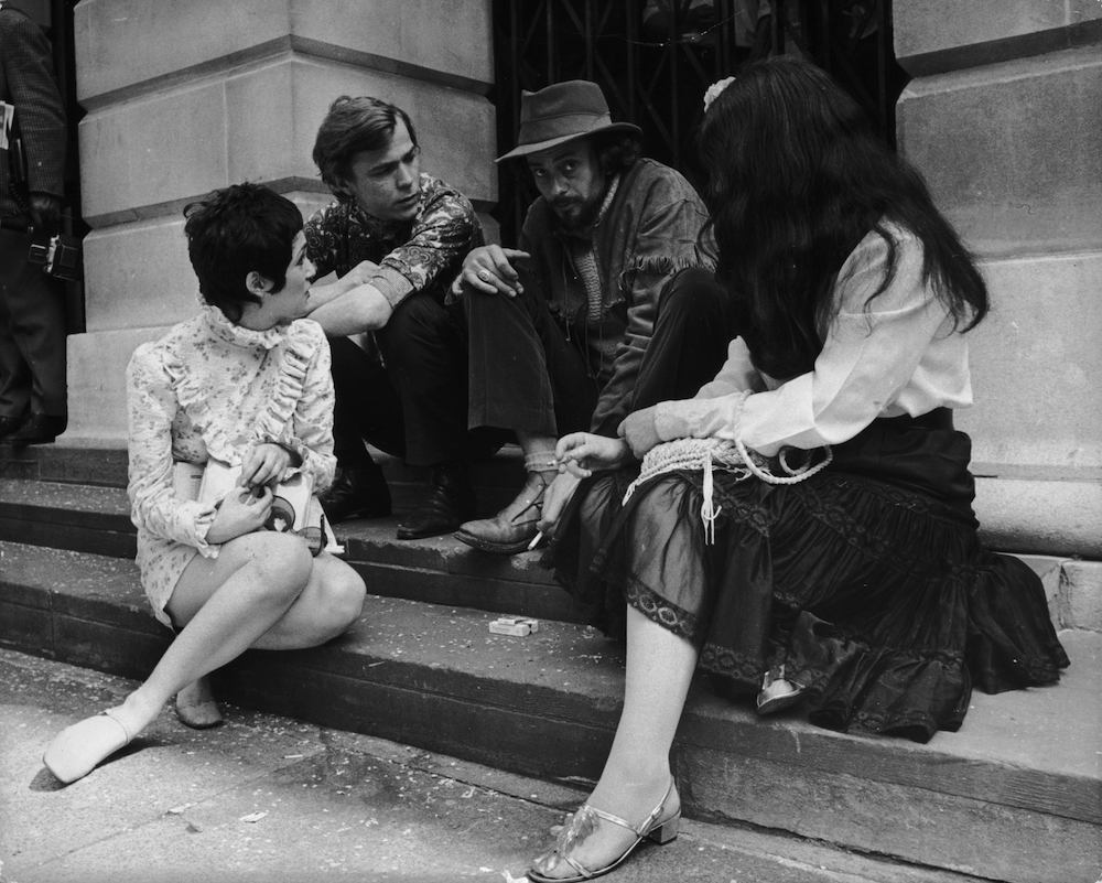 15th June 1968: Freelance photographer John 'Hoppy' Hopkins sits dejectedly on the steps of St Pancras Register Office, after his wedding to Suzy Creamcheese was postponed for the second time in two days. This time the bride failed to appear, due to suspected appendicitis. (Photo by Bob Aylott/Keystone/Getty Images)