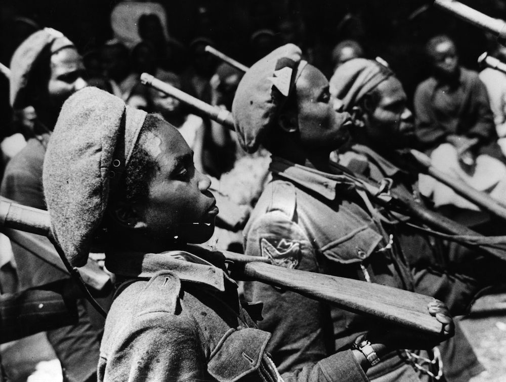 20th December 1963: Field Marshal Mwariama's nine year old son on parade with other Mau Mau soldiers. (Photo by Central Press/Getty Images)