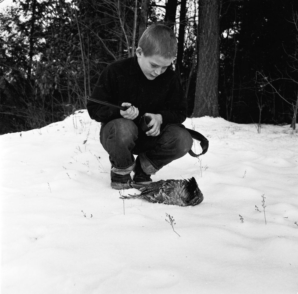 circa 1955: A youngster has shot his first partridge on a hunting trip with his father. (Photo by John Titchen/Three Lions/Getty Images)