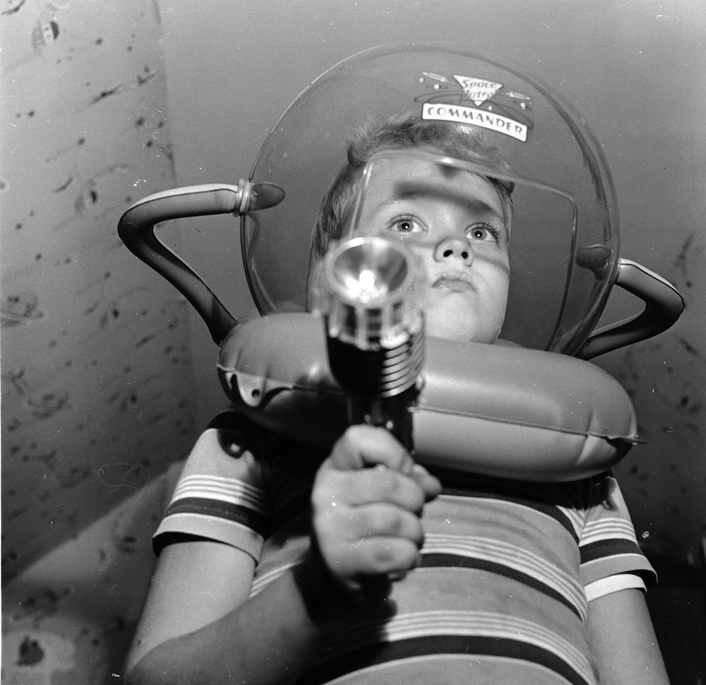 circa 1955: Young television star Glenn Walken dressed up in a space helmet at home in Bayside, Long Island. (Photo by Orlando /Three Lions/Getty Images)