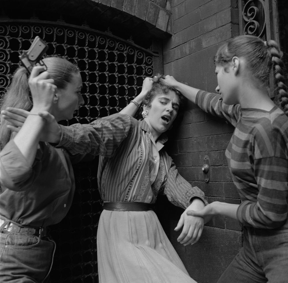 circa 1955: Members of a teenage girl gang convincing an unwilling recruit to join the gang. (Photo by Vecchio/Three Lions/Getty Images)
