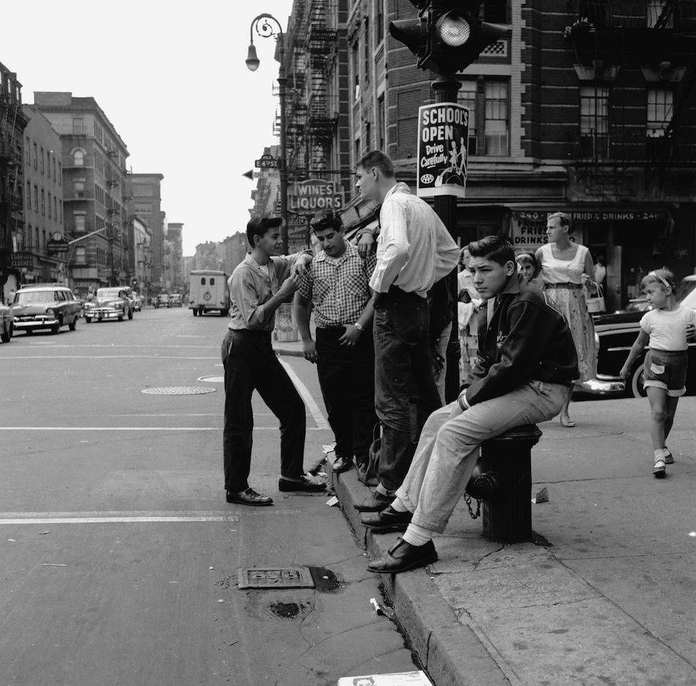 circa 1955: A teenage street gang 'hanging out' on a street corner in New York City. (Photo by Carl Purcell/Three Lions/Getty Images)