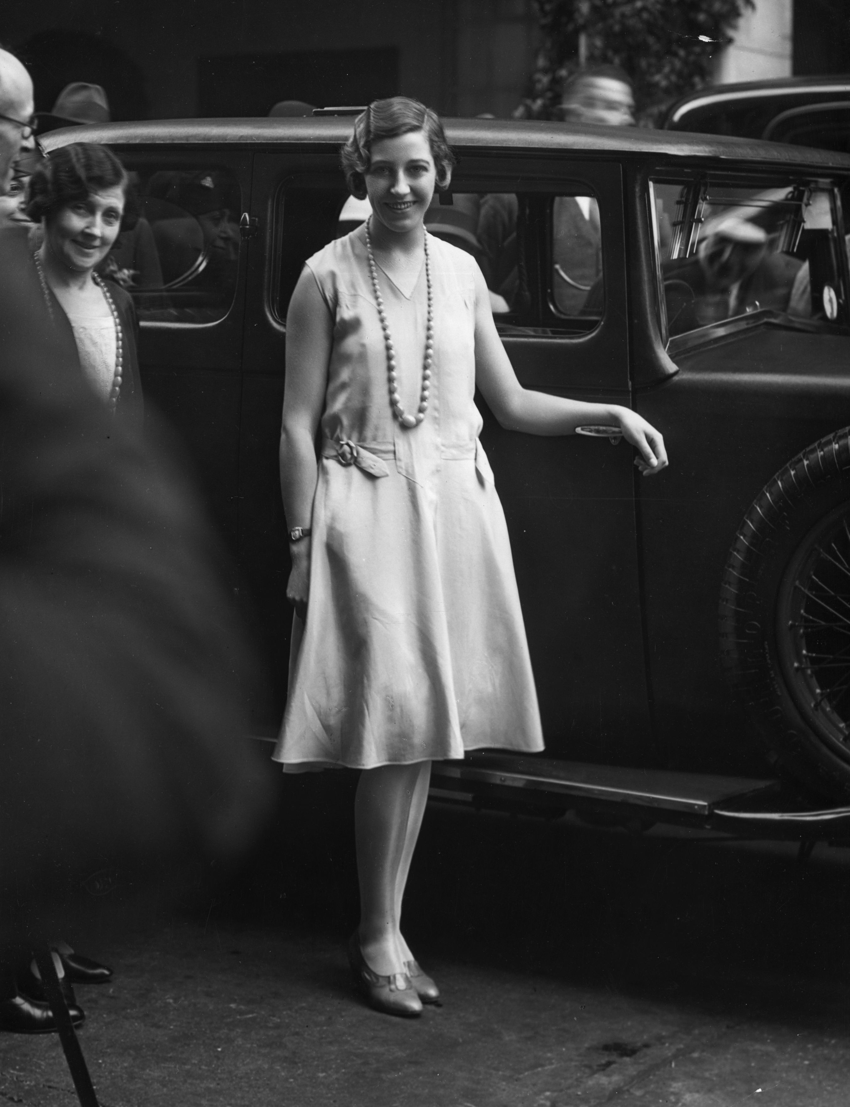 July 1930: British aviation pioneer Amy Johnson (1903 - 1941) arriving at a function in London. (Photo by Sasha/Getty Images)