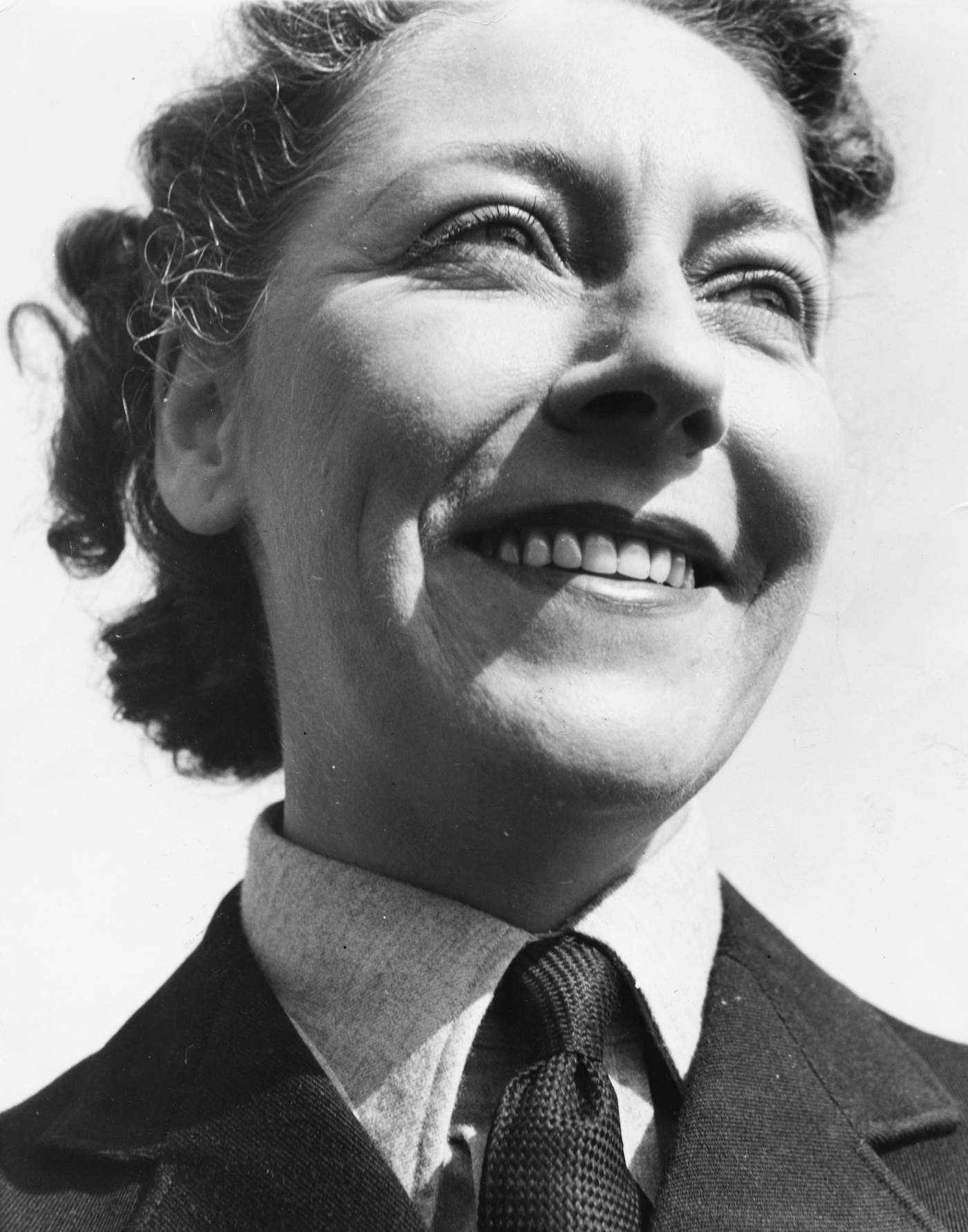 Portrait of aviator Amy Johnson, wearing a tie and uniform, circa 1930. (Photo by Fox Photos/Hulton Archive/Getty Images)