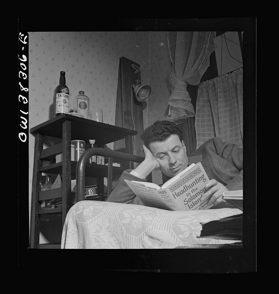 Washington, D.C. A clerk in the U.S. Navy Department reading in his room in a boardinghouse