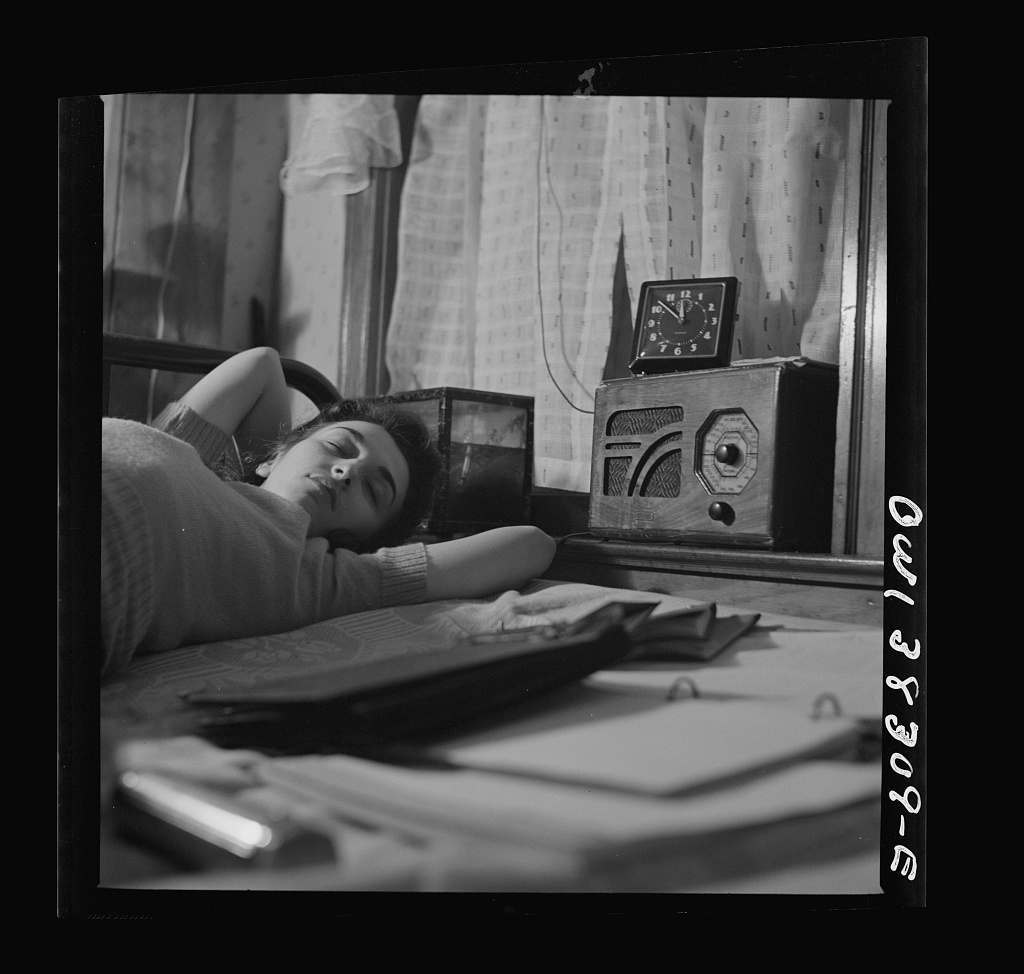 Washington, D.C. A radio is company for this girl in her boardinghouse room
