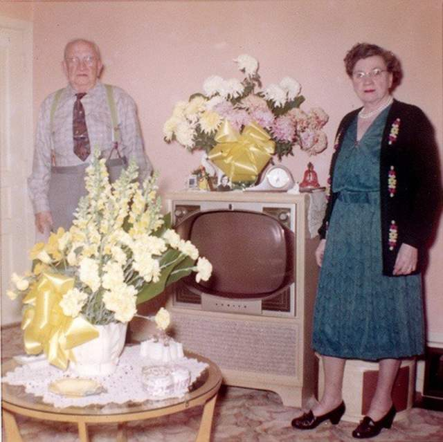 retro vintage TV people standing by them