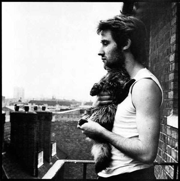 With Mingus the cat, Dellow House, east London, early 80s.