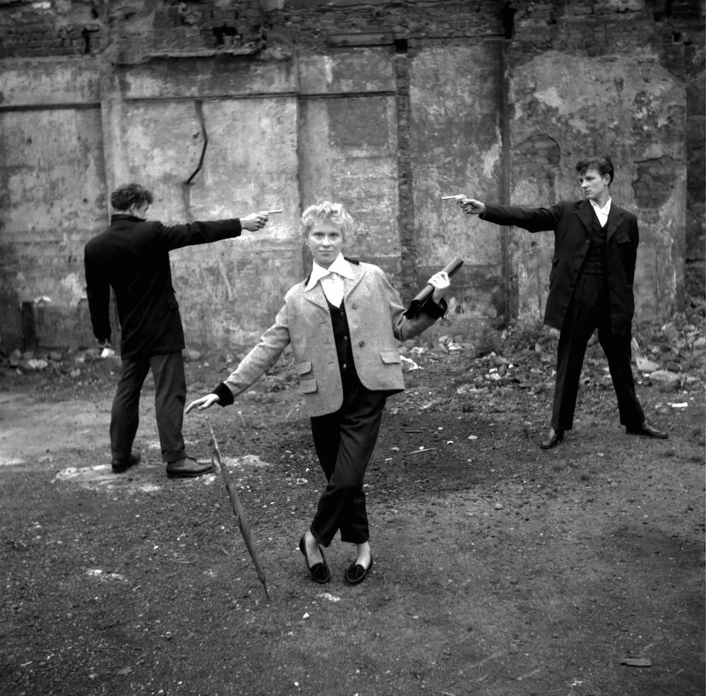 "A Question of Honour ©2006 TopFoto/Ken Russell Photo by Ken Russell, January 1955 From a series: ""The last of the Teddy Girls"" 16 year old Eileen from Bethnal Green, with two teddy boys ""duelling"" over her on an East End bombsite."