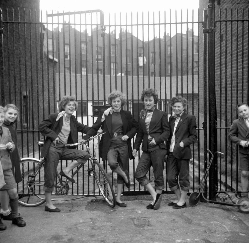 Photo by Ken Russell - January 1955 The Last of the Teddy Girls Elsie (15) and Rose Hendon with Mary Toovey and Jean Rayner (14) in front of the Seven Feathers Club in Edenham Street, North Kensington. ©2006 TopFoto/Ken Russell