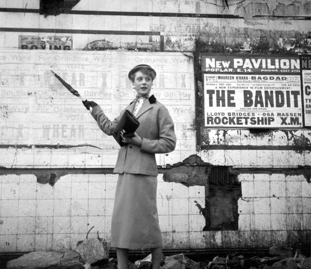 Photo by Ken Russell - January 1955 The last of the Teddy Girls Barbera Wood pointing to a council election poster for Ordnance Ward in Poplar, East London. ©2006 TopFoto/Ken Russell