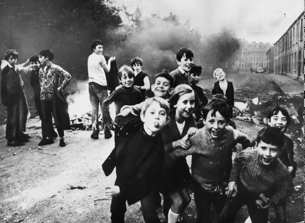 7th December 1971: Children jeer at British soldiers whiile a fire smoulders in the street behind them. (Photo by Keystone/Getty Images)