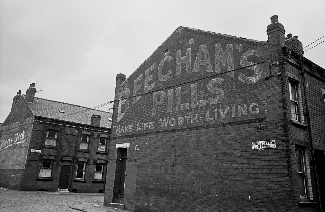 Advertising sign on Leeds back to back housing Cross Oswald St 1970