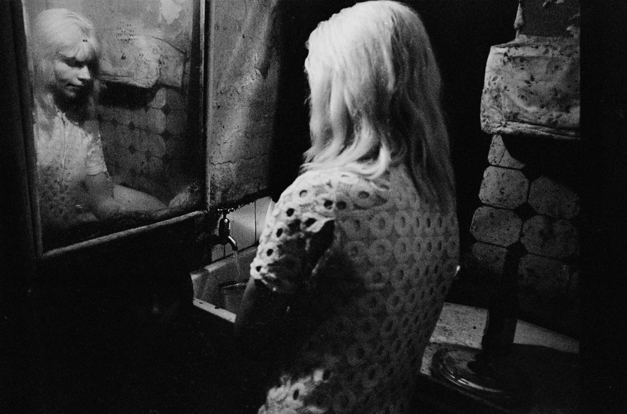 At the kitchen sink in a tenement flat Glasgow 1970