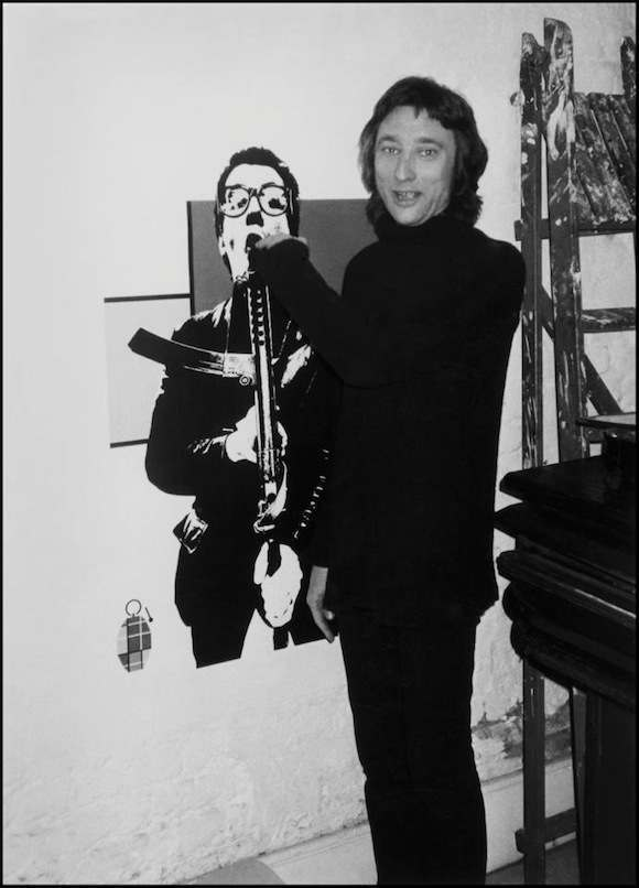 Barney Bubbles with poster/programme for Elvis Costello & The Attractions' 1979 Armed Forces tour, west London, 1979. Photo: Chalkie Davies