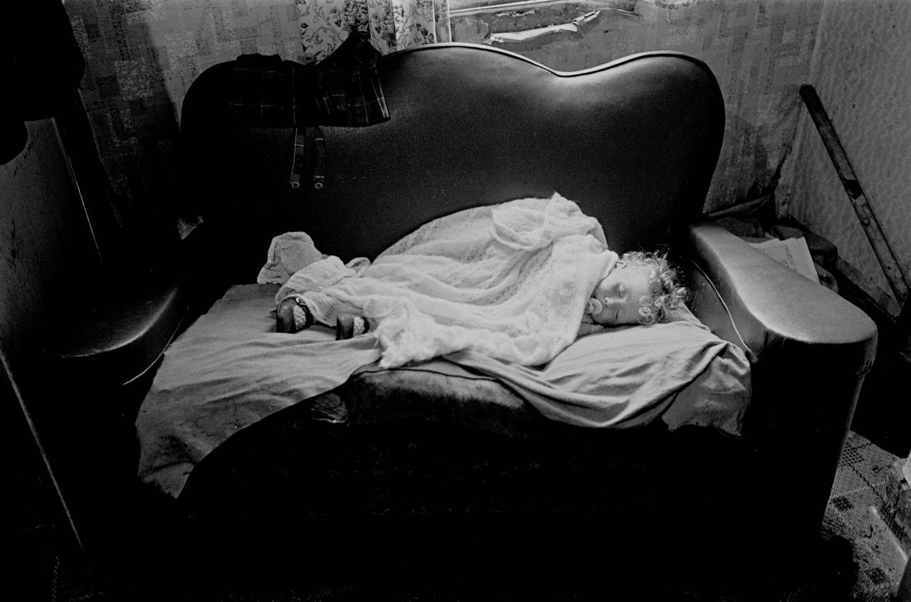 Baby asleep in slum property Balsall Heath 1970