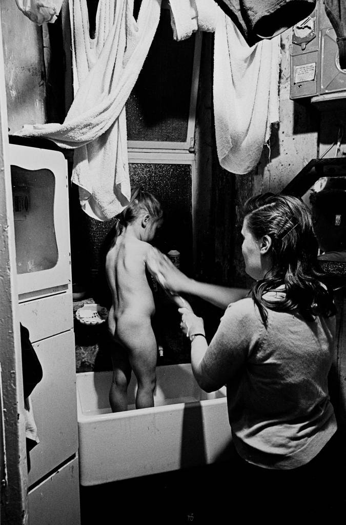 Bathtime in the kitchen for Peggy Rump's daughter, Rothschild Dwellings 1969 43-29