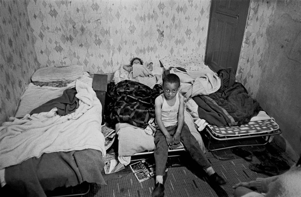 Bedroom of a grossly overcrowded house in Liverpool 8 1971