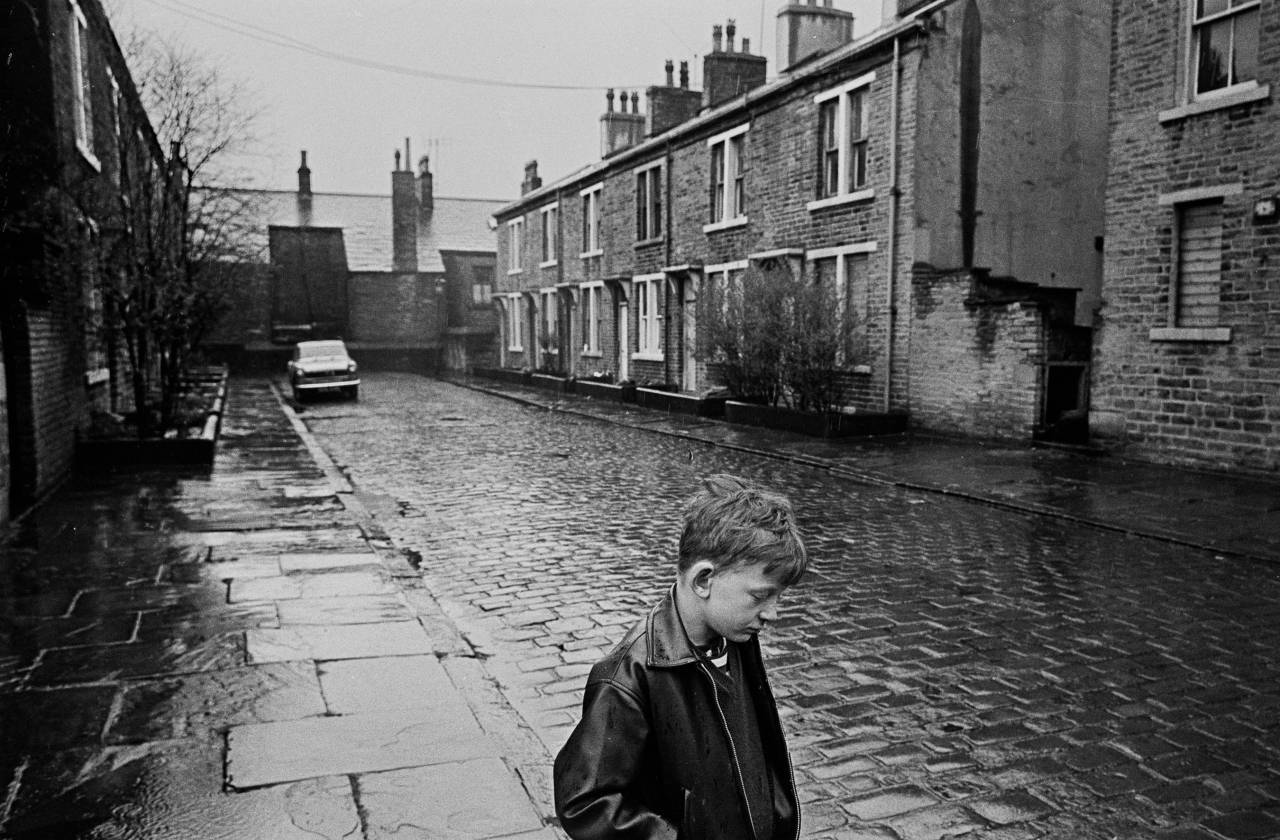 Boy standing in the rain, Forster St Bradford 1969