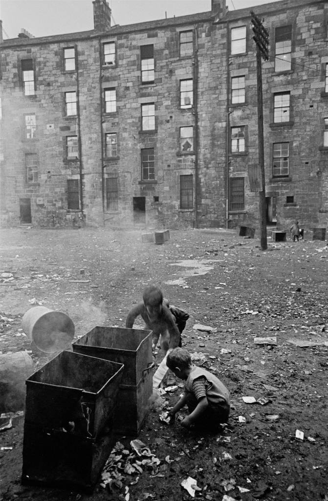 Boys setting fire to waste bins Gorbals 1970