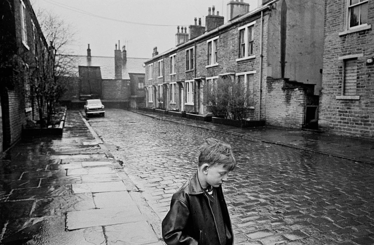 Bradford, 1969 A boy standing in the rain on Forster Steet